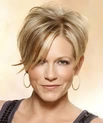 medium length tapered or layered hairstyles for women over 50 short straight casual hairstyle with side swept bangs medium