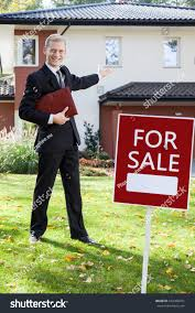 young handsome real estate agent showing stock photo 244300471