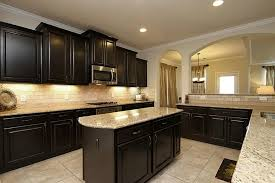 kitchen ideas with brown cabinets warm the kitchen with dark cabinets light countertops modern