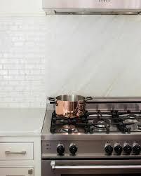 marble slab cooktop backsplash transitional kitchen