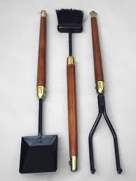 wrought iron with wood handle fire tools in the style of george