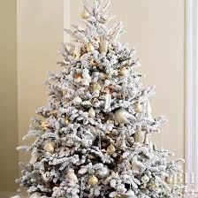 lightly flocked christmas tree decorated christmas trees better homes gardens