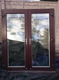 Blinds For Upvc French Doors - upvc french doors brown mahogany white interior with white blinds