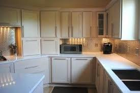 how to stain unfinished maple cabinets chagne stain maple cabinets silestone quartz in white