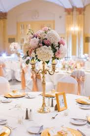 candelabra centerpiece gold candelabra centerpiece with blush and ivory flowers pinteres