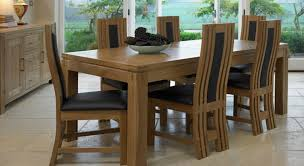 Glass Wood Dining Room Table Fabulous Black Leather Chairs And Sleek Solid Wood Dining Table