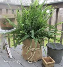 wrap burlap around a plastic bucket for a quick and inexpensive