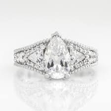 art deco style multi stone ring with 2 0 carat pear center 14k