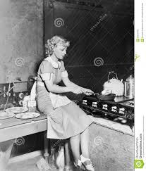 young woman sitting on the counter and cooking food in the kitchen