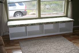 Window Seat Bookshelves White Wooden Window Seat With Bookshelves Under It Placed On The