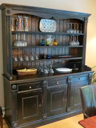 primitive decor kitchen cabinets with brown countertop and black
