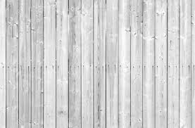 seamless background texture of white painted wooden wall stock
