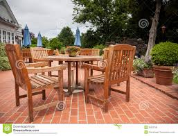 Teak Table And Chairs Teak Patio Tables And Chairs On Brick Deck Royalty Free Stock