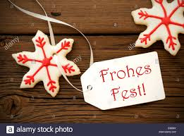 the german words frohes which means merry on a white