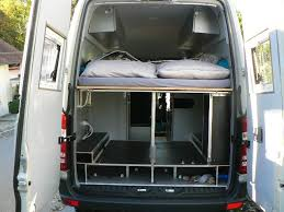mercedes sprinter rv conversion rear view of the bed and storage in tom zwilling s mercedes