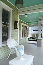 green porch light wicker swing porch traditional with blue