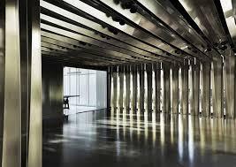 bureau d architecture folded brass ribbons envelope bureau de change s office design