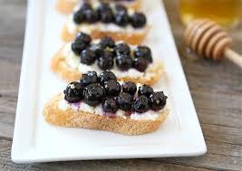 berry canapes roasted blueberry ricotta crostini blueberry crostini recipe two