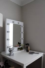 wide white painted oak wood dressing table with lighted mirror of