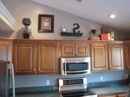 How To Decorate Above Cabinets by Kitchen Decorating Ideas For Above Cabinets Sleek Black Electric