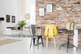 brick wall apartment modern apartment with brick wall dining table chair and sofa