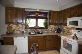 kitchens with different colored cabinets how to restain cabinets darker stained cabinets colors staining