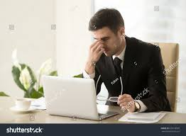 Tired Work Hours Exhausted Tired Businessman Working On Laptop Stock Photo