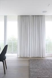 Floor To Ceiling Curtains Floor To Ceiling Soft Drapes And Oatmeal Woven Carpet For Minimal