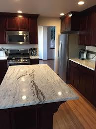 cherry cabinets in kitchen dark cherry cabinets with white granite countertops www