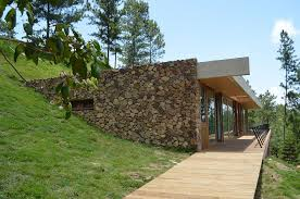 homes built into hillside grass roofed home built into slope uses hillside for cooling walls