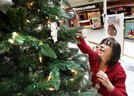 salvation army giving tree bedecked with kids u0027 names to donate