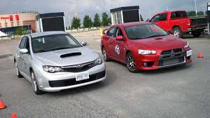 used mitsubishi evo mitsubishi lancer evolution vs subaru wrx sti used vehicle comparison