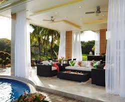 tropical patio ideas patio tropical with heat lamps glass railing