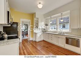 yellow kitchen walls white cabinets kitchen interior with white cabinets yellow walls and wood floor