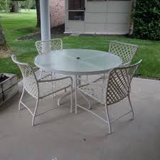 Glass Patio Table And Chairs Brown Tamiami Glass Top Patio Table And Four Chairs Ebth