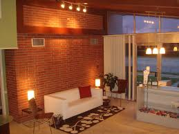 exposed brick wall lighting wondrous natural living room areas decor with white modern tuxedo
