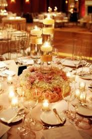 candle centerpiece wedding a mix of candles and florals at the president hotel president