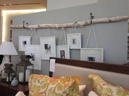 hang pictures without frames a branch of birch and frames stairways crates and barrels