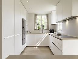 opulent small u shaped kitchen design with white paint color and