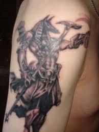 stunning simple angry egyptian god tattoo design for men on upper