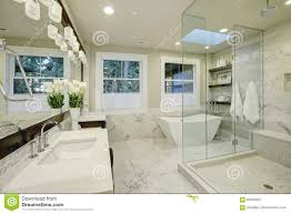 amazing master bathroom with large glass walk in shower stock