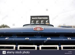 Ford Vintage Truck - a ford badge and grill on the front of a classic blue pickup truck