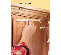 how to add crown moulding to cabinets how to install crown molding on kitchen cabinets