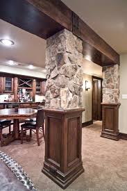 wood beam stone columns traditional basement other by