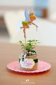 tinkerbell party ideas centerpiece from a tinkerbell fairy garden birthday party via
