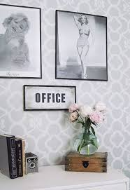 pictures for office walls adding drama to a boring office wall little house of four