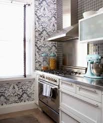 kitchen with black white damask wallpaper and mosaic glass tile