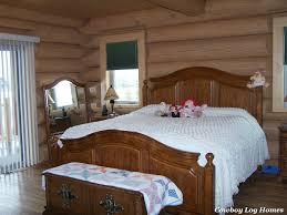 first floor master suites in log home plans cowboy log homes