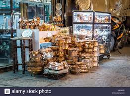 copper dishes for sale on bazaar of isfahan next to naqsh e jahan