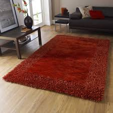 sable two shiney shaggy rugs in burnt orange free uk delivery